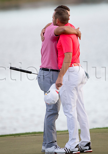 28.02.2016. Palm Beach, Florida, USA.  Adam Scott hugs playing partner Sergio Garcia after winning the final round of the Honda Classic at the PGA National Resort & Spa in Palm Beach Gardens, FL.