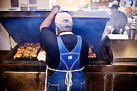 Pitmaster Ed Mitchell prepares lunch at The Pit in Raleigh, NC.