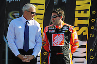 Nov. 16, 2008; Homestead, FL, USA; NASCAR Sprint Cup Series former champion Dale Jarrett (left) talks with Tony Stewart during the Ford 400 at Homestead Miami Speedway. Mandatory Credit: Mark J. Rebilas-