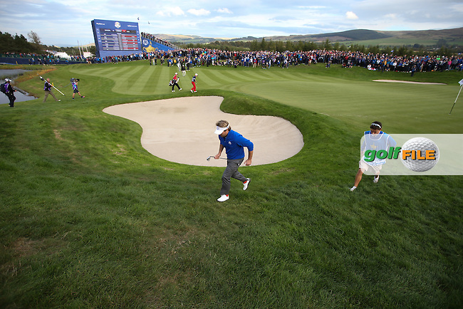 Victor Dubuisson (EUR) heads off the green to make a chipshot on the 16th during Sunday's Singles at the 2014 Ryder Cup from Gleneagles, Perthshire, Scotland. Picture:  David Lloyd / www.golffile.ie