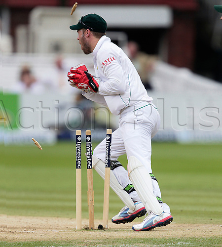 20.08.2012 London, England.  A B de Villiers takes the bails off to have James Taylor run out in the first session on day five of the third test between England and South Africa from Lords.
