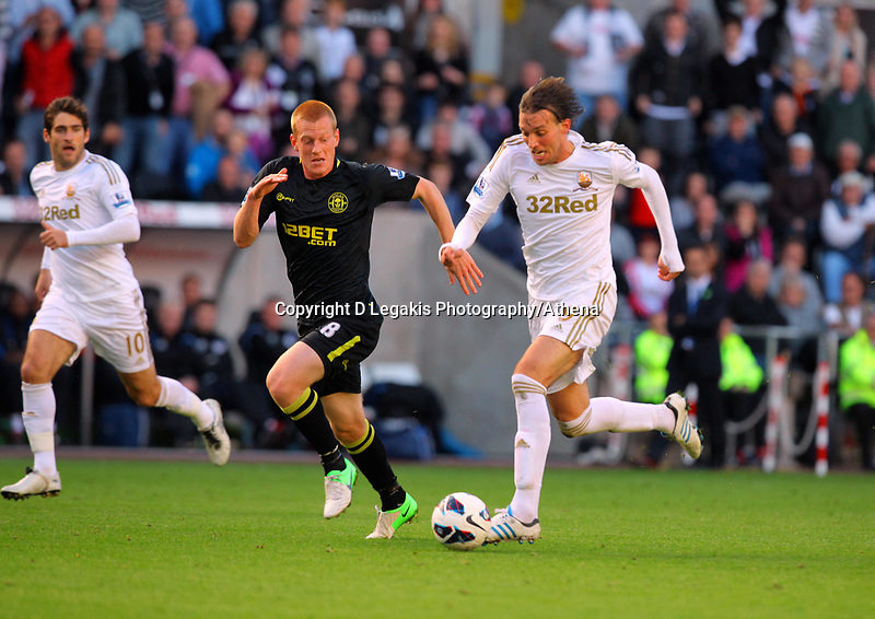 Saturday, 20 October 2012<br /> Pictured: Michu of Swansea (R) marked by Ben Watson of Wigan (L)<br /> Re: Barclays Premier League, Swansea City FC v Wigan Athletic at the Liberty Stadium, south Wales.