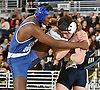 Peter Pappas of Plainview JFK, right, battles Tyrese Byron of Long Beach at 152 pounds during the Nassau County Division I varsity wrestling finals at Hofstra University on Sunday, Feb. 12, 2017. Pappas won by decision to claim the county championship.