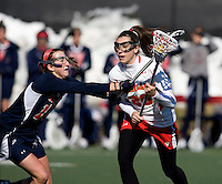 Kate Faas (26) of Maryland has the ball taken out of her stick by  Bria Eulitt (18) of Richmond at the practice turf field in College Park, Maryland.  Maryland defeated Richmond, 17-7.