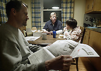 10-year-old Michael O'Reilly-Birtcher, right, eats breakfast with his adoptive parents Thom O'Reilly, center, and Harold Birtcher in their home Thursday, Feb. 16, 2006, in Upper Arlington, Ohio. Because same-sex partners are barred from joint adoption in Ohio, O?Reilly and Birtcher, who have been together for 25 years, went to Oregon three years ago to jointly adopt Michael. A bill introduced in the Ohio Legislature this month would bar all gays and lesbians from adoptions and foster care.<br />