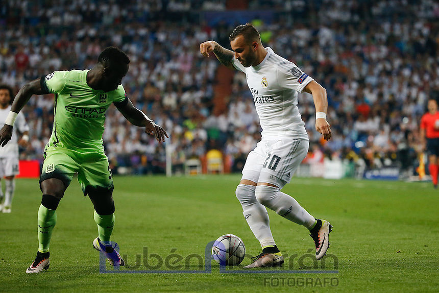 Real Madrid&acute;s Spanish forward Jes&eacute; Rodriguez and Manchester City&acute;s defense Bacary Sagna<br />  during the UEFA Champions League match between Real Madrid and Manchester City at the Santiago Bernabeu Stadium in Madrid, Wednesday, May 4, 2016.