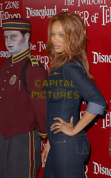 TYRA BANKS.The Twilight Zone Tower of Terror Premiere Party .May 4,2004.half length, half-length, denim, jean, hand on hip.www.capitalpictures.com.sales@capitalpictures.com.©Capital Pictures