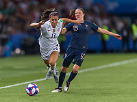 PARIS,  - JUNE 28: Alex Morgan #13 is tackled by Élise Bussaglia #15 during a game between France and USWNT at Parc des Princes on June 28, 2019 in Paris, France.