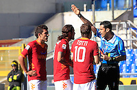 Calcio, Serie A: Roma-Fiorentina. Roma, stadio Olimpico, 25 aprile 2012. L'arbitro Christian Brighi, a destra, espelle l'attaccante della Roma Pablo Daniel Osvaldo, secondo da sinistra, affiancato dai compagni di squadra Marquinho, sinistra, e Francesco Totti..Referee Christian Brighi, right, gives a red card to AS Roma forward Pablo Daniel Osvaldo, second from left, past AS Roma midfielder Marquinho, of Brazil, and AS Roma forward Francesco Totti, during the Italian Serie A football match between AS Roma and Fiorentina, at Rome Olympic stadium, 25 april 2012..UPDATE IMAGES PRESS/Riccardo De Luca