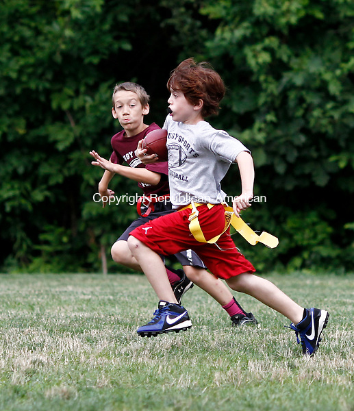 Naugatuck, CT- 29 July 2014-072914CM02- Tommy DiPerna carries the ball for a touchdown for team Gray during a Naugatuck youth flag football league game at Linden Park in Naugatuck on Tuesday.  Giving chase is Garnet's James Duda.    Christopher Massa Republican-American