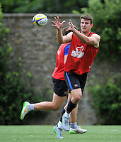 Ollie Devoto of Bath Rugby receives the ball. Bath Rugby training session on August 4, 2015 at Farleigh House in Bath, England. Photo by: Patrick Khachfe / Onside Images