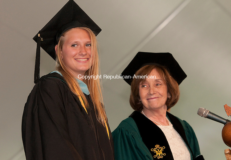WATERBURY, CT--050915JS09- Jane Bailey,  Provost, right, introduces Post University (Main Campus) Valedictorian Miranda Polaski, left,  during the Post University's 2015 Commencement Saturday at Post University in Waterbury. <br /> Jim Shannon Republican-American