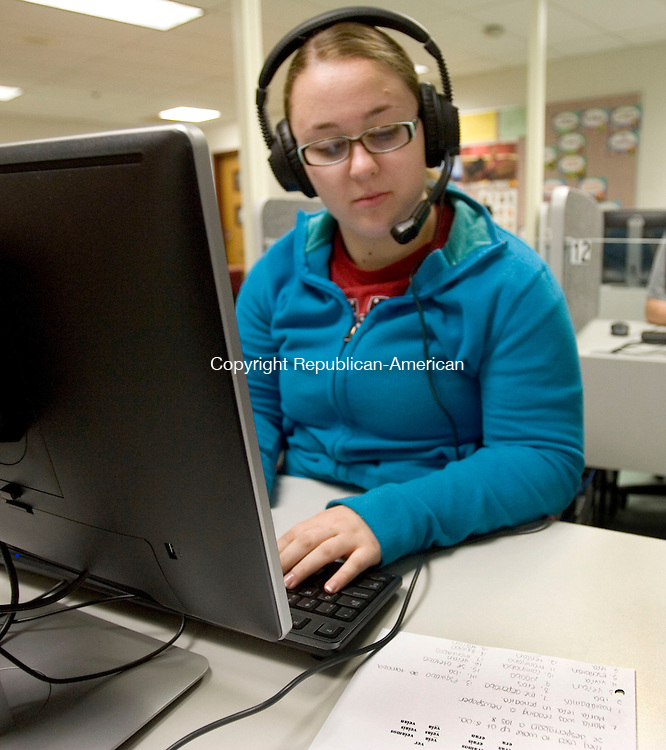 CHESHIRE CT. 28 April 2014-042817SV08-Courtney Caldwell, 17, of Cheshire listens to a lesson on a headset in a new state of the art language lab at Cheshire High School in Cheshire Monday.<br /> Steven Valenti Republican-American