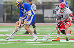 Orange, CA 03-05-17 - Parker Halaburda (Chapman #9) and Joe Lee (UCLA #22) in action during the UCLA - Champman Southern Lacrosse Conference MCLA Division 1 Men's Lacrosse game.