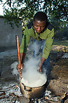 Cook preparing breakfast for anti-poaching scouts before deployment, Kafue National Park, Zambia