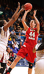 SIOUX FALLS, SD - MARCH 11:  Lisa Loeffler #44 from the University of South Dakota shoots the ball over the defense of Shawnece Teague #23 from IUPUI in the second half of their semifinal game Monday afternoon during the Summit League Tournament in Sioux Falls, SD. (Photo by Dave Eggen/Inertia)