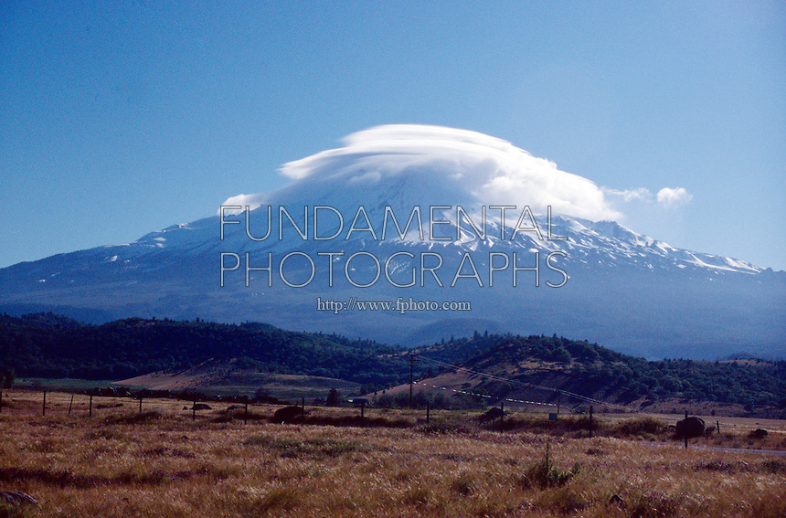 WEATHER<br /> Lenticular Clouds Over Mount Shasta, CA<br /> These clouds form as air passes over mountains reaching a point where the air reaches saturation, condenses and forms the cloud. The air must be fairly dry yet still contain some moisture.