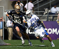 Ned Crotty (22) of Duke tries to turn the corner on Kevin Ridgway (35) of Notre Dame during the NCAA Men's Lacrosse Championship held at M&T Stadium in Baltimore, MD.  Duke defeated Notre Dame, 6-5, to win the title in overtime.