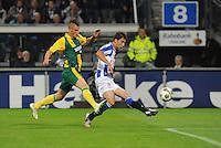 VOETBAL: HEERENVEEN: Abe Lenstra Stadion, 15-09-2012, SC Heerenveen - ADO Den Haag, Eindstand 1-3, Vito Wormgoor (#3 | ADO), Filip Djuricic (#9 | SCH), ©foto Martin de Jong..