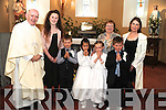Pupils from Tulloha NS, Bonane, Kenmare who made their First Holy Communion in St Fiachna's Church, Bonane, on Sunday were Eoghan Llywelyn, Mika Fitzmaurice, Aoibhe Carey and Vaughan O'Brien pictured here with Fr Michael Moynihan and teachers Carrie Spillane, Maire Healy and Cait Ni Neill.