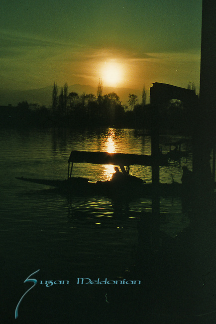 Greenish Silhouette of Kashmir Lake and boats