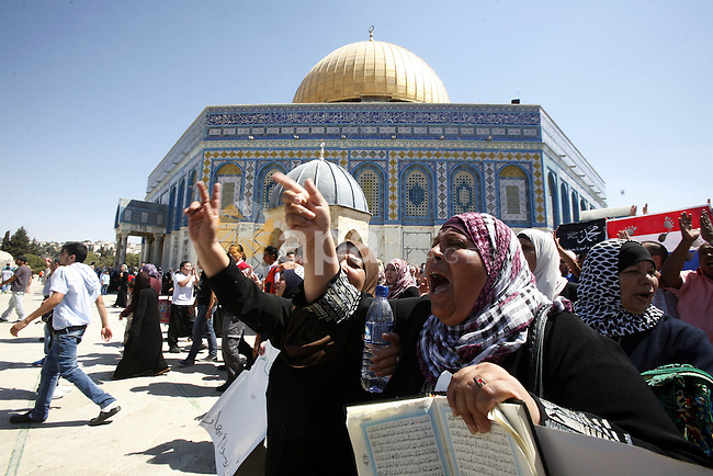 Palestinian women shout slogans during a demonstration against the controversial film 'Innocence of Muslims' in front of al-Aqsa Mosqe in Jerusalem, on September 14, 2012. The controversial low budget film reportedly made by an Israeli-American which portrays Muslims as immoral and gratuitous, sparked fury in Libya, where four Americans including the ambassador were killed on Tuesday when a mob attacked the US consulate in Benghazi, and has led to protests outside US missions in Morocco, Sudan, Egypt, Tunisia and Yemen. Photo by Mahfouz Abu Turk