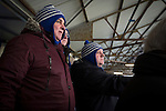 Greenock Morton 2 Stranraer 0, 21/02/2015. Cappielow Park, Greenock. Three home supporters in matching hats watching from the Shed as Greenock Morton take on Stranraer in a Scottish League One match at Cappielow Park, Greenock. The match was between the top two teams in Scotland's third tier, with Morton winning by two goals to nil. The attendance was 1,921, above average for Morton's games during the 2014-15 season so far. Photo by Colin McPherson.