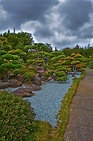 "An image of the treel-lined path through the Japanese Gardens has been ""adjusted"", giving it a surreal look."