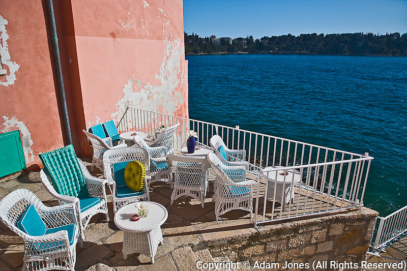 Outdoor patio seating along the Adriatic Sea, Rovigno, Croatia
