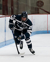 BOSTON, MA - FEBRUARY 16: Emily Rickwood #25 of University of New Hampshire brings the puck forward during a game between University of New Hampshire and Boston University at Walter Brown Arena on February 16, 2020 in Boston, Massachusetts.