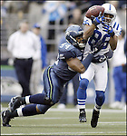 Seattle Seahawks' linebacker D.D. Lewis hits Indianapolis Colts' wide receiver Troy Rogers as he catches the ball during the second quarter of NFL action Saturday, Dec. 24, 2005 in Seattle. (AP Photo/Jim Bryant)