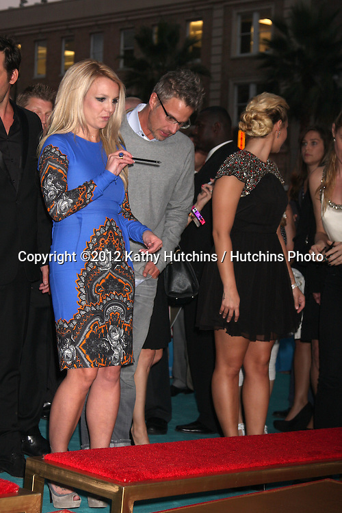 LOS ANGELES - SEP 11:  Britney Spears, Jason Trawick at the FOX  X-Factor Judges Handprint Ceremony at Graumans Chinese Theater on September 11, 2012 in Los Angeles, CA