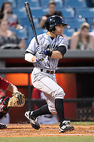 Omaha Storm Chasers shortstop Lance Zawadzki #14 at bat during a game against the Nashville Sounds at Greer Stadium on April 25, 2011 in Nashville, Tennessee.  Omaha defeated Nashville 2-1.  Photo By Mike Janes/Four Seam Images