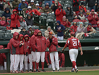 NWA Democrat-Gazette/ANDY SHUPE<br />Arkansas starter Kacey Murphy is greeted by teammates at the dugout steps after Murphy left the game following a base hit by South Carolina Saturday, April 14, 2018, during the seventh inning at Baum Stadium. Visit nwadg.com/photos to see more photographs from the game.
