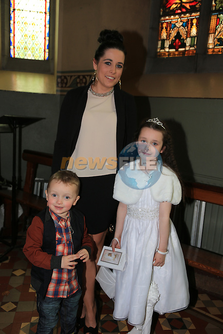 Kim Reilly Brannigan who made first her  communion in St Marys church with Kim Branigan and Darragh reilly Branigan.Picture: Fran Caffrey / www.newsfile.ie ..