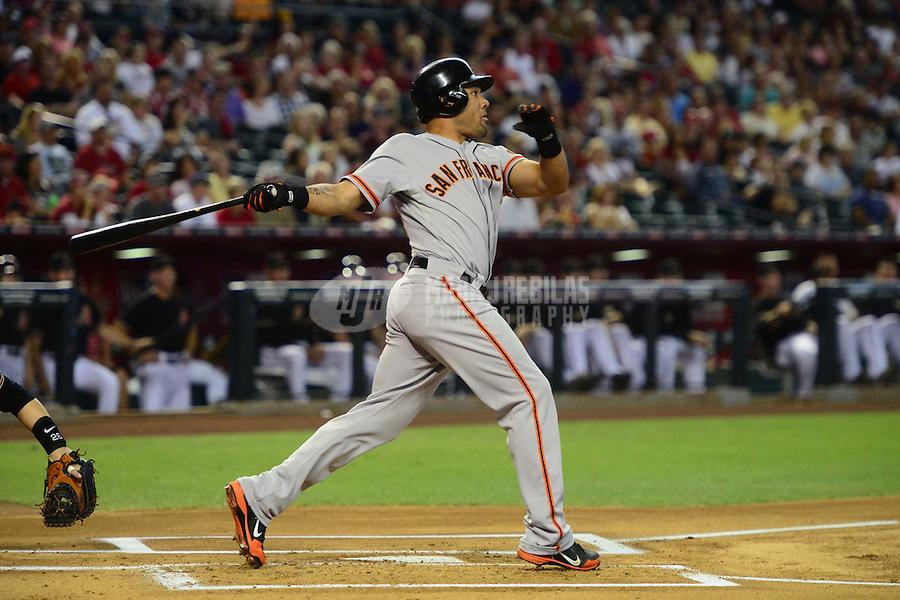 May 12, 2012; Phoenix, AZ, USA; San Francisco Giants outfielder Melky Cabrera at bat against the Arizona Diamondbacks at Chase Field. Mandatory Credit: Mark J. Rebilas-