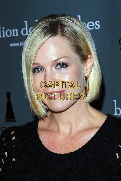 JENNIE GARTH .BillionDollarBabes.com LA Sale Opening Night  held at the The Petersen Automotive Museum, Los Angeles, California, USA, .5th November 2009..portrait headshot gold hoop earrings black .CAP/ADM/TC.©T. Conrad/AdMedia/Capital Pictures.