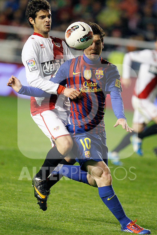 Rayo Vallecano's Aitor Nunez (l) and FC Barcelona's Leo Messi during La Liga match.April 29,2012. (ALTERPHOTOS/Acero)