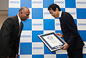 Kiichiro Miyata (R) Managing Executive Officer and CTO of Omron Corporation receives a Guinness World Record certificate for the robot FORPHEUS during the CEATEC Japan exhibition on October 3, 2016, Tokyo, Japan. FORPHEUS is the world's first robot table tennis tutor and will appear in the Guinness World Records 2017 Edition. (Photo by Rodrigo Reyes Marin/AFLO)