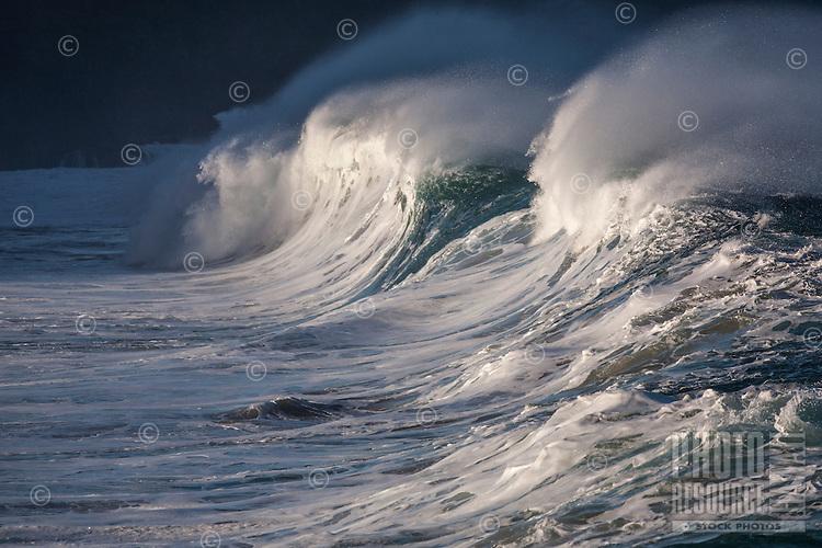 A big hollow wave breaking at Waimea Shorebreak, North Shore, O'ahu.