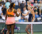 Timea Bacsinszky (SUI) and Serena Williams (USA) shake hands after their quarterfinal match. Serena defeated a tough Bacsinszky with a score of 75 63 at the BNP Parisbas Open in Indian Wells, CA on March 18, 2015.