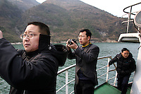 CHINA. Chongqing Province.  Toursists travelling through the 3 Gorges. The flooding of the three Gorges, by damming the Yangtze near the town of YiChang, has remained a controversial subject due to the negative environmental consequences and the displacement of millions of people in the flood plain. The Yangtze River however is reported to be at its lowest level in 150 years as a result of a country-wide drought. It is China's longest river and the third longest in the world. Originating in Tibet, the river flows for 3,964 miles (6,380km) through central China into the East China Sea at Shanghai.  2008.