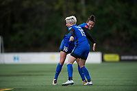 Seattle, WA - Saturday April 22, 2017: Megan Rapinoe and Carson Pickett celebrate during a regular season National Women's Soccer League (NWSL) match between the Seattle Reign FC and the Houston Dash at Memorial Stadium.