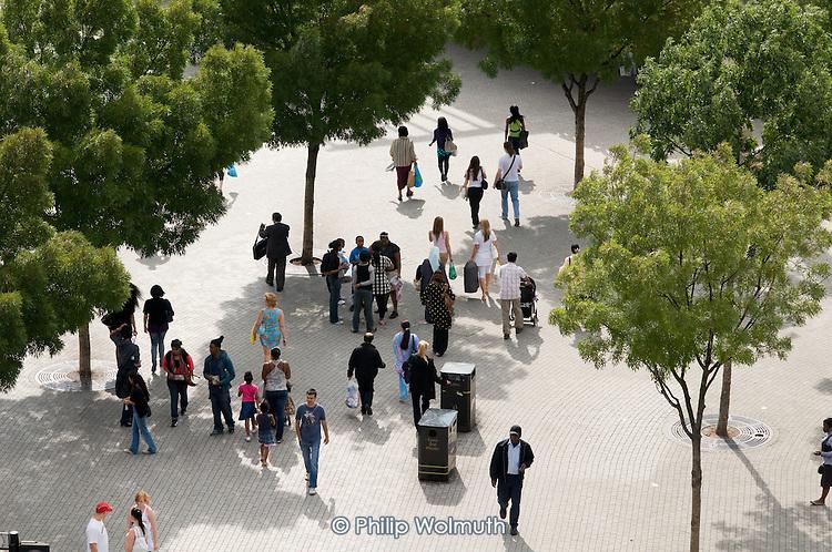Passengers walk towards Stratford train station in East London.
