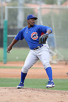 Charles Thomas of the Chicago Cubs participates in intrasquad spring training games at the Cubs complex on March 21, 2011  in Mesa, Arizona. .Photo by:  Bill Mitchell/Four Seam Images.