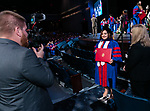 Students have their photos taken after being hooded at the DePaul University College of Law commencement ceremony, Sunday, May 14, 2017, at the Rosemont Theatre in Rosemont, IL, where some 240 students received their Juris Doctors or Master of Laws degrees. (DePaul University/Jeff Carrion)