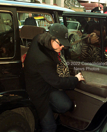 Washington, DC - January 30, 1999 -- Monica Lewinsky arrives at the Mayflower Hotel where her testimony in the President's Impeachment trial will be taken..Credit: Ron Sachs / CNP