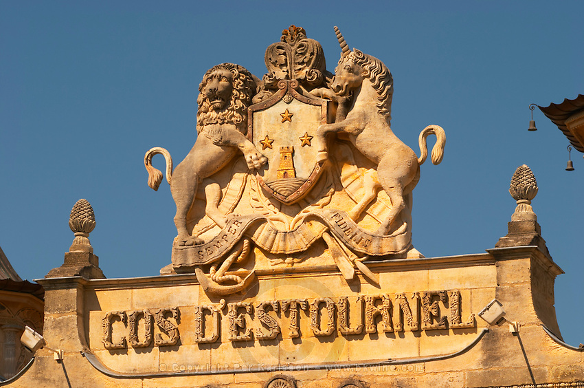 The entrance portico to the elaborately decorated winery with text and coat of arms showing a tower, a lion, a horse, at Cos d'Estournel in oriental style, Saint St Estephe, Medoc, Bordeaux