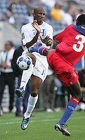 Frantz Gilles (3) kicks at Allan Lalin (left). Honduras defeated Haiti 1-0 during the First Round of the 2009 CONCACAF Gold Cup at Qwest Field in Seattle, Washington on July 4, 2009.