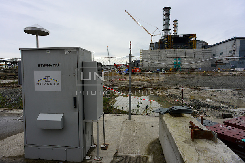 Air control systems set between 4th reactor of Chernobyl Power plant and construction site to provide constant monitoring and alarm in case of radioactive pollution.